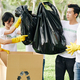 Volunteers putting garbage bags in boxes - PhotoDune Item for Sale
