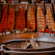 Salmon fish smoked on open fire at Christmas market in Hamburg, Germany - PhotoDune Item for Sale
