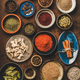 Flat-lay of various spices in bowls over rusty background - PhotoDune Item for Sale