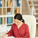 Successful Asian Woman Working at Desk - PhotoDune Item for Sale