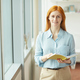 Red Haired Businesswoman Posing by Window - PhotoDune Item for Sale