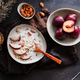 High angle view of morning porridge with almond and sliced plum - PhotoDune Item for Sale