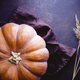 High angle view of a big pumpkin on a table. Halloween of Thanksgiving concept. - PhotoDune Item for Sale