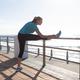 Female jogger stretching on seaside - PhotoDune Item for Sale