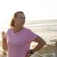 Female jogger relaxing on seaside - PhotoDune Item for Sale