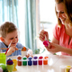 Happy young mother and son are painting Easter eggs - PhotoDune Item for Sale