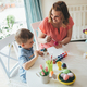 Mother and son are painting eggs - PhotoDune Item for Sale