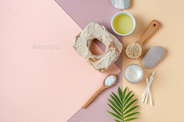 Accessories, olive oil and body care cosmetics on a light pastel background. - Stock Photo - Images