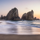 Portugal Ursa Beach at coast of Atlantic Ocean. Sea stack rocks in sunset lit. Foamy waves rolling - PhotoDune Item for Sale