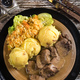 Braised pork tongues in horseradish sauce served with potatoes and salad. - PhotoDune Item for Sale
