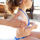 Mom puts sunscreen on the shoulders of her daughter. - PhotoDune Item for Sale