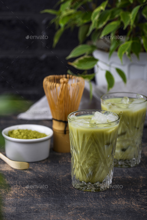 Cold matcha tea with milk and ice - Stock Photo - Images