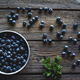 Bowl of blueberries on a wooden background. Healthy food, health - PhotoDune Item for Sale
