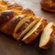 Easter greek tsoureki braid, sweet bread brioche on wood - PhotoDune Item for Sale