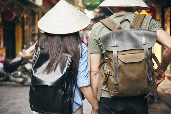 Back view of tourist with backpack exploring the city - Stock Photo - Images