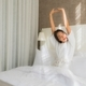 Portrait beautiful young asian woman relax smile on bed in bedroom - PhotoDune Item for Sale