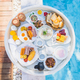 Floating breakfast set in tray with fried egg omelette sausage ham bread fruit milk juice coffee - PhotoDune Item for Sale