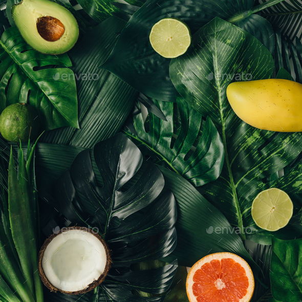Creative layout made of summer tropical fruits and leaves. Flat lay. Food concept. - Stock Photo - Images