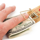 Hand and mousetrap with money - PhotoDune Item for Sale