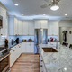 Beautiful luxury kitchen with quartz and granite countertops and white cabinets. - PhotoDune Item for Sale