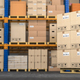 Warehouse or storage with cardboard boxes on a pallet. Logistics and mail delivery concept. - PhotoDune Item for Sale