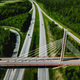 Aerial top view of cable-stayed Suspension bridge and Highway road with green forests in Finland. - PhotoDune Item for Sale