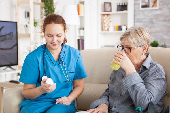 Medical Nurse Helping Senior Woman In Nursing Home Stock Photo By Dc Studio