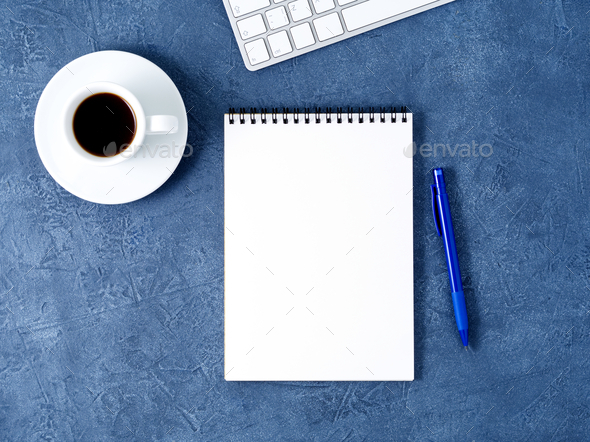 The open notepad with clean white page, pen and coffee cup on aged dark blue stone table, top view - Stock Photo - Images