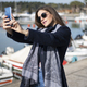 Beautiful business woman taking selfies in marina - PhotoDune Item for Sale