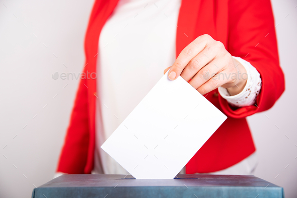 Woman votes on election day. - Stock Photo - Images