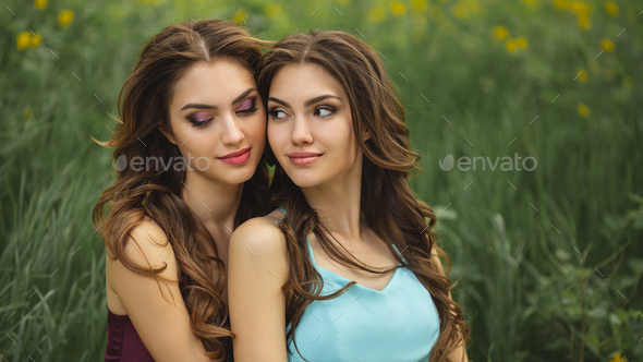Fashion Portrait Photo of Two Women Against Green Grass Meadow on Nature - Stock Photo - Images