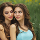 Fashion Portrait Photo of Two Women Against Green Grass Meadow on Nature - PhotoDune Item for Sale