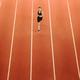 female runner on track in stadium - PhotoDune Item for Sale