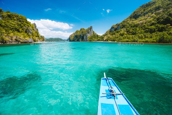 Trip tourist boat in blue shallow water lagoon. Discover exploring unique nature, journey to - Stock Photo - Images