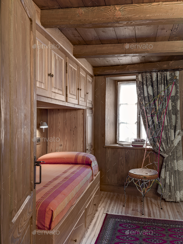 Interior of a Rustic Bedroom with Beamed Ceiling - Stock Photo - Images