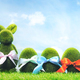 Grassy Easter eggs and bunny on green grass. - PhotoDune Item for Sale