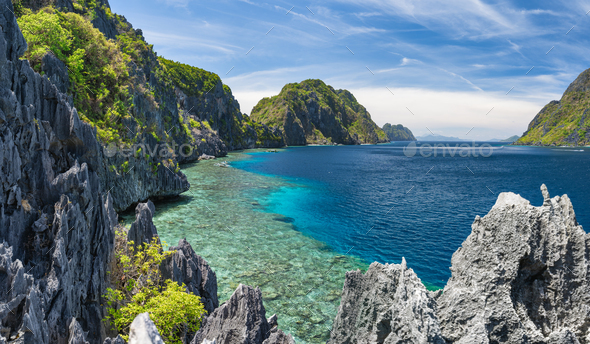 El Nido, Palawan, Philippines. Tapiutan strait with tourist boats. View from Matinloc island located - Stock Photo - Images