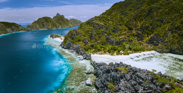 Aerial panoramic view of karst sharp cliffs of limestone island on adventures tour of El Nido - Stock Photo - Images
