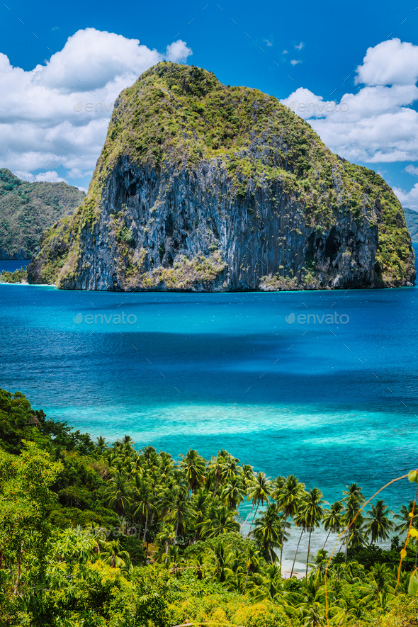 Breathtaking view of tropical coast with jungle and Pinagbuyutan Island in the blue ocean El Nido - Stock Photo - Images