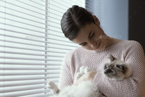 Woman holding her beautiful cat - Stock Photo - Images