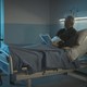 Lonely elderly man reading a book at the hospital - PhotoDune Item for Sale