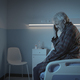 Sad lonely senior sitting in a hospital bed at night - PhotoDune Item for Sale