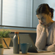 Young woman sitting at desk and using her laptop - PhotoDune Item for Sale