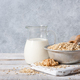 Oat flakes, milk and cookies on wooden table - PhotoDune Item for Sale