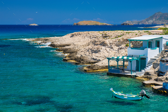 Crystal clear blue water at MItakas village beach, Milos island, Greece - Stock Photo - Images