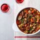 Beef Bourguignon Stew with Vegetables and Red wine. Grey Background. Top view. - PhotoDune Item for Sale