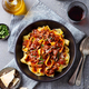 Pasta Pappardelle with Beef Ragout Sauce in Black bowl. Grey Background. Top view. - PhotoDune Item for Sale