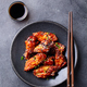Chicken wings. Traditional asian recipe. Dark background. Copy space. Top view. - PhotoDune Item for Sale