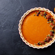 Pumpkin pie in baking dish. Black slate background. Copy space. Top view. - PhotoDune Item for Sale