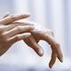 Woman applying moisturizing cream on hands - PhotoDune Item for Sale